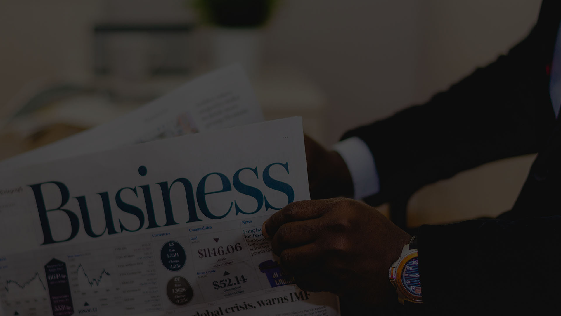Reading business section of newspaper